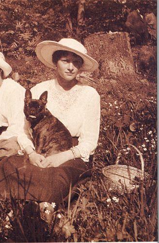 Tatiana Nikolaevna Romanov & her French Bulldog.  Birth: June, 10, 1897 Birth Place: Peterhof, Russian Empire
