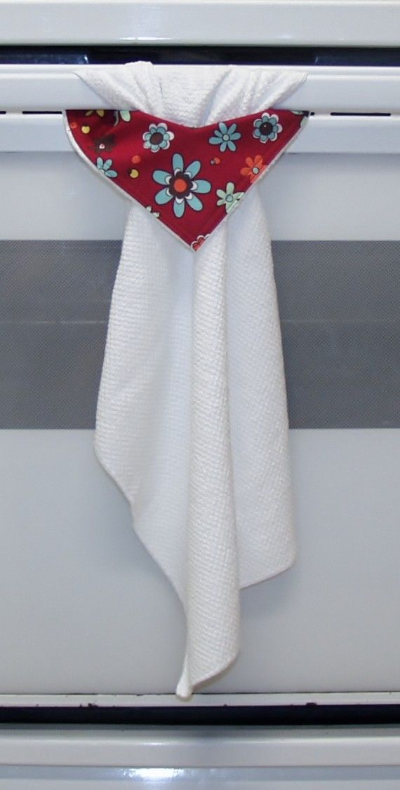 Stay-Put Towel... (link is dead - but I see how the towel is made - a hole in one corner with deco fabric, then pulled through.