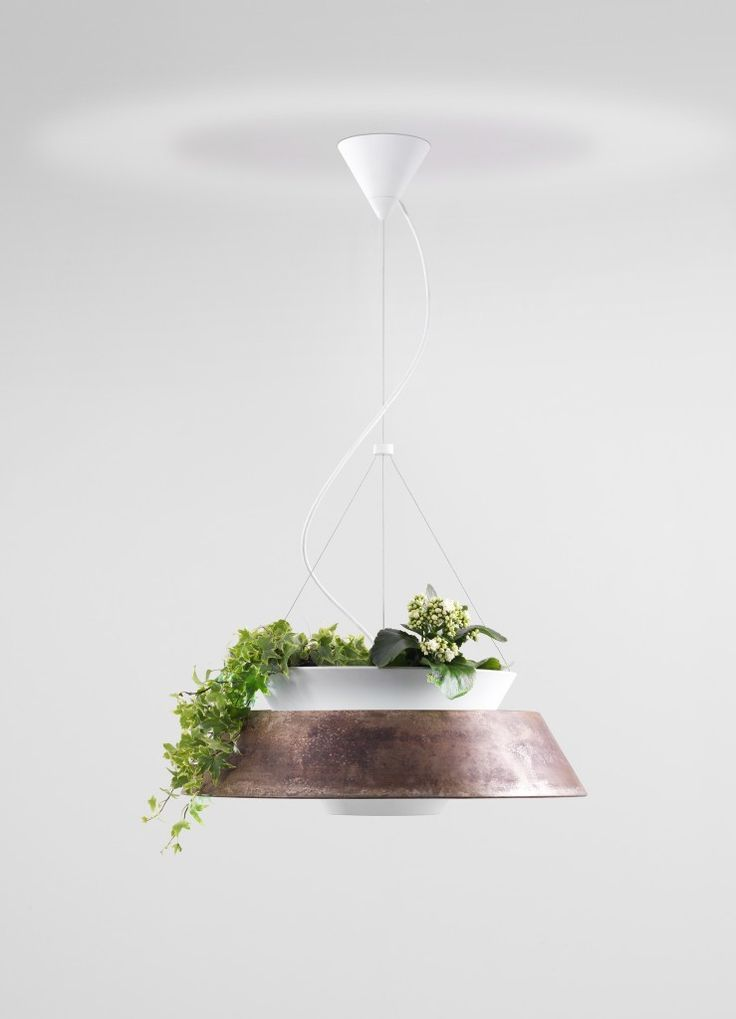 New design prospects with a dual use: Eden is a collection of painted metal lamps consisting of the insertion of two containers having a double role: shell for the illuminating device and flower pots container. #Eden