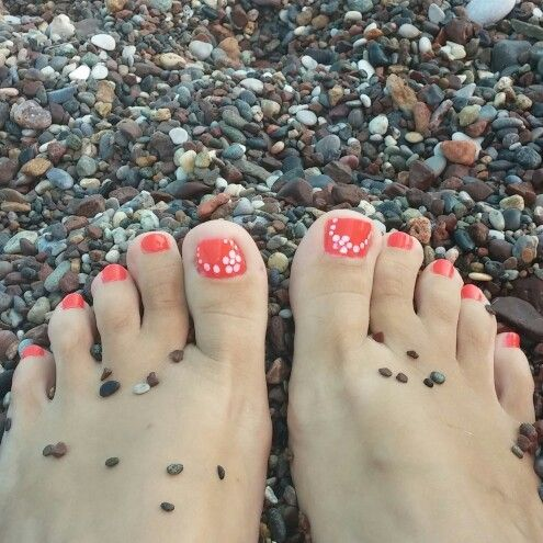 Pedicure with orly nail polish and flower designs...summer is almost over...!