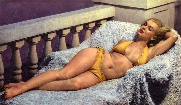 Marilyn Monroe circa 1951 The world's biggest icon! Her tummy isn't tightly toned, her thighs touch, her arms aren't skinny, she has stretch marks and her boobs aren't perky. She is known as one of the MOST BEAUTIFUL women in history. Be confident girls. You are HOT, you are SEXY, you are a Marilyn so do not let any man, media or moment of judgement ever take away your confidence! ♥