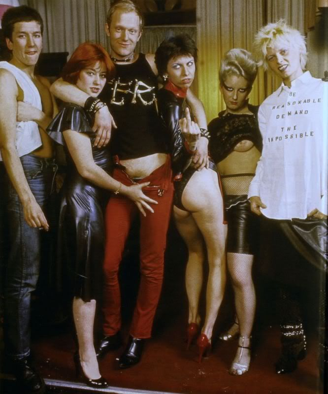 Sex, Malcolm McLaren & Vivienne Westwood's shop open from 1974-76, London (from left: Steve Jones, unknown, Alan Jones, Chrissie Hynde, Jordan, and Vivienne Westwood)