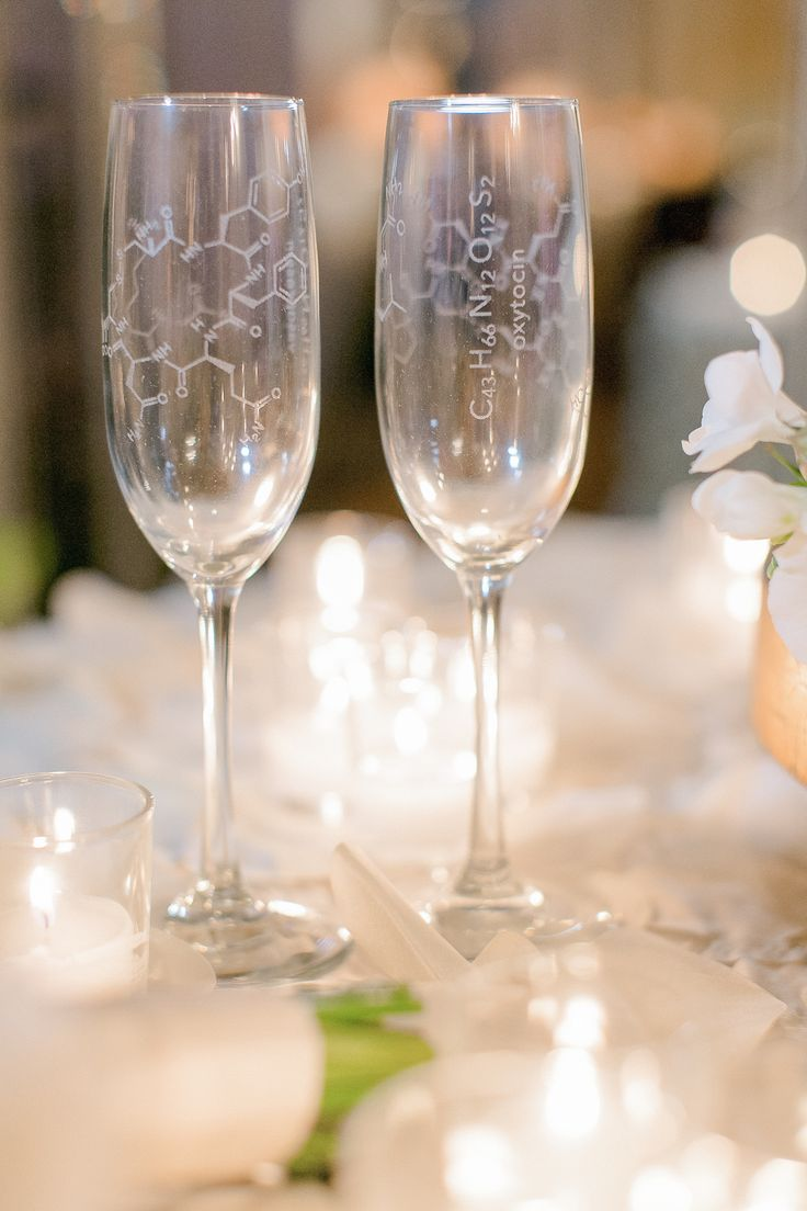 Champagne Flutes with Oxytocin Diagram Formula | Photography: Arte de Vie. Read More: http://www.insideweddings.com/weddings/modern-wedding-with-southern-traditions-in-new-orleans-louisiana/712/