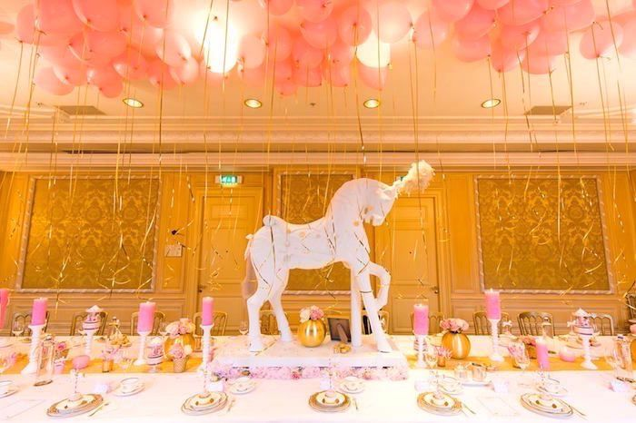 Dining table from a carousel baby shower via kara 39 s party for Baby clothesline decoration baby shower