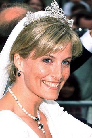 """On her wedding day to Queen Elizabeth's youngest son, Prince Edward, Sophie Rhys~ Jones wore a tiara from the Queen's private collection. The tiara consisting of three open-work scroll motifs, designed and remodeled by the Crown Jeweler, David Thomas, at Asprey and Garrard. If only all brides could have a """"something borrowed"""" such as this.  As a side note, her Prince designed the pearl wedding jewelry."""