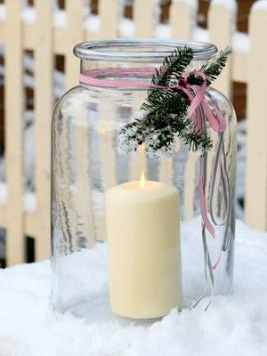 BIIIIG jar with medium sized candle with xmas tree clippings attached with a purty bow