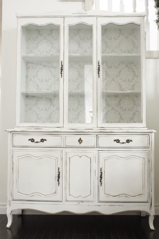 Beautiful hutch, love the wallpaper use.