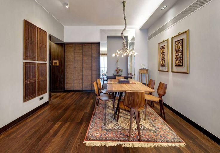 Diese Wohnung in Hong Kong kombiniert traditionelle asiatische Elemente mit Design-Klassikern im Vintage-Stil und wirkt dabei trotzdem modern.