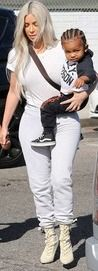 She is passing down her impeccable style sense to her offspring. And Kim Kardashian was at it again as she carried son Saint who sported new hip corn rows in his hair in Los Angeles on Thursday.