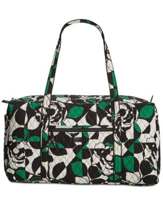 Fun, fashionable and perfectly-sized for weekends away, this spacious duffle packs plenty of style in its durable quilted construction. By Vera Bradley. | Cotton | Wipe clean | Imported | Large sized