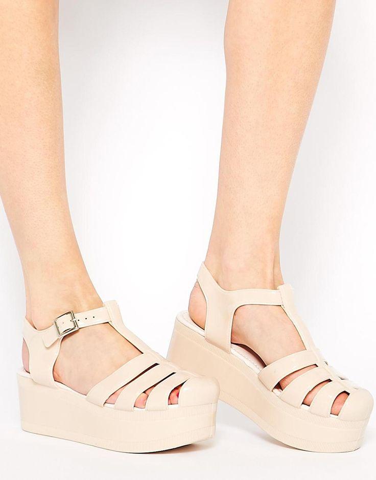 Imagen 1 de Zapatos de goma con plataforma plana HAPPY de ASOS