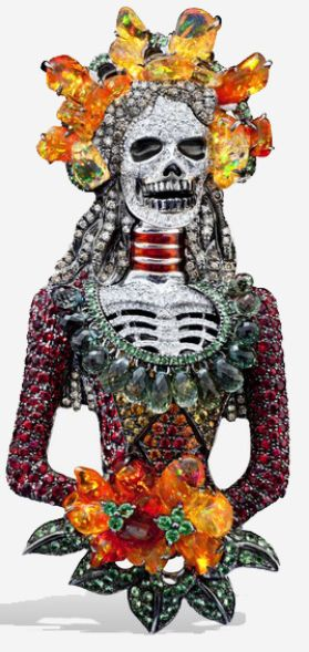 Lydia Courteille's Santa Muerte pendant with opals, sapphires, white diamonds, rubies. Via Diamonds in the Library.