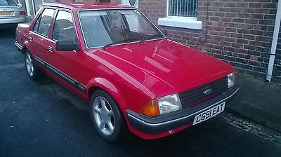 1986 Ford Orion L Red   - http://classiccarsunder1000.com/archives/32632