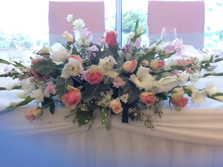 Lovely pastel bridal table arrangement by www.newminsterfunctiondesign.com