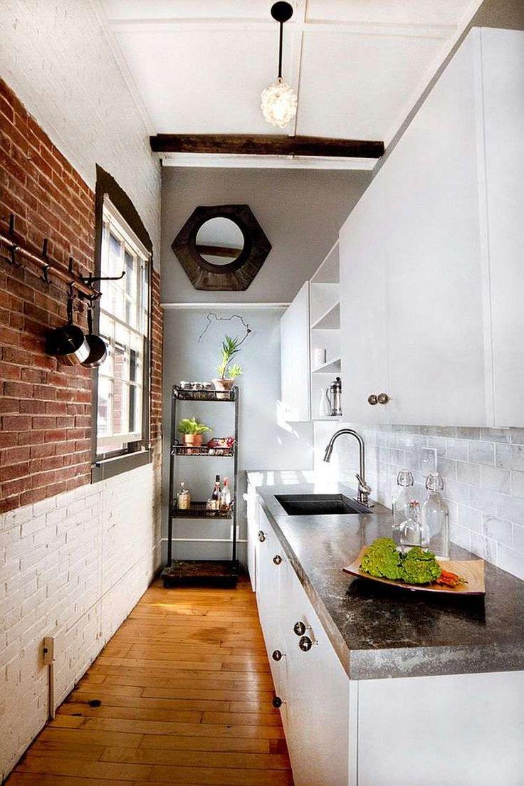 petite cuisine de style industriel revisit avec parquet brique de parement blanche et rouge comme