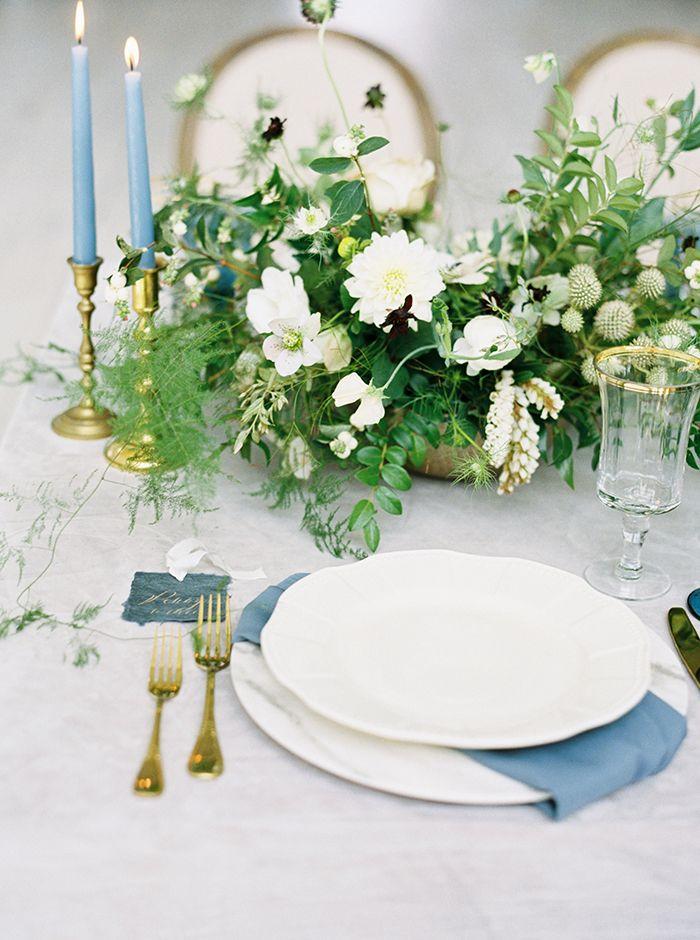 Elegant White and Blue Place Setting with Greenery and Vintage Gold Decor  https://heyweddinglady.com/moody-blues-grays-southern-barn-wedding/    #wedding #weddings   #weddinginspiration #bluewedding #barnwedding #weddingflowers #tablescape #weddingdecor #centerpiece #vintagewedding
