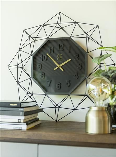 Wall clock Hatsu by COCO maison with a black metal design frame.