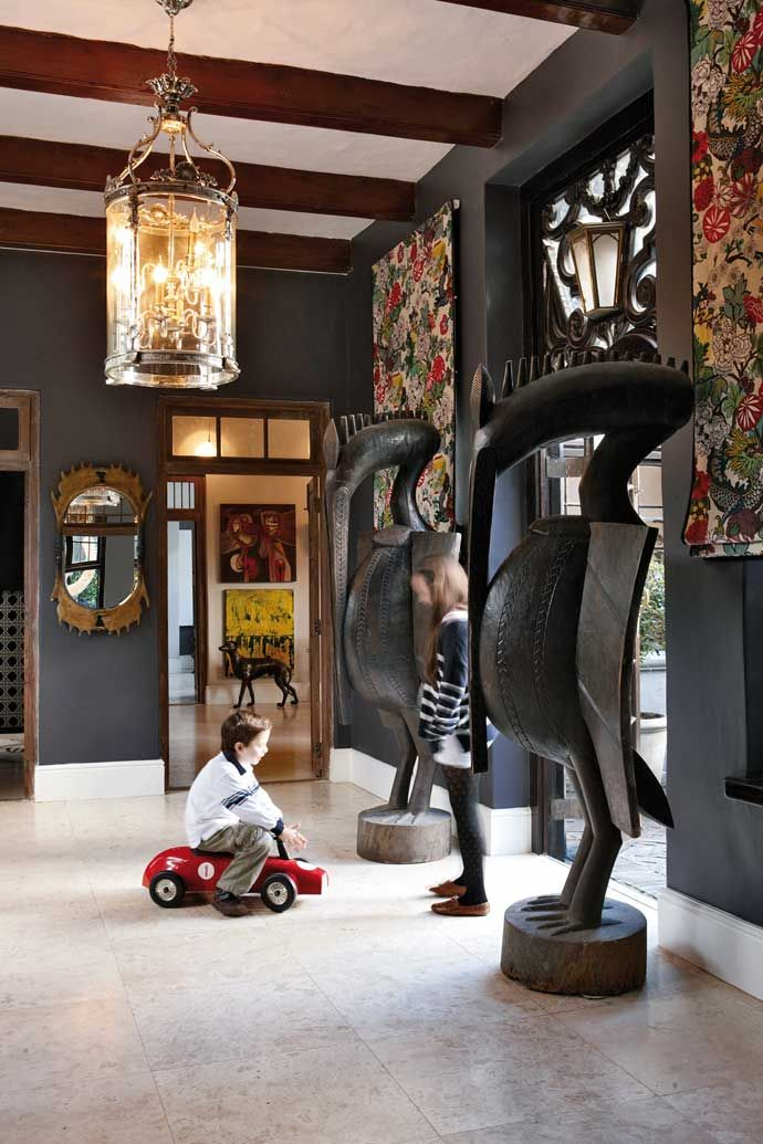 The Entrance Hall Of This Constantia Home Features West African Senufo Bird Statues From Amatuli