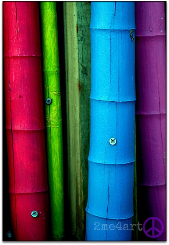painted bamboo fence.g...love the idea of colorful bambo
