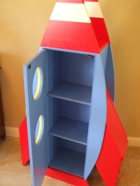 Rocketship bookcase by Brian Hulett Woodworking. hulettwoodworking@gmail.com