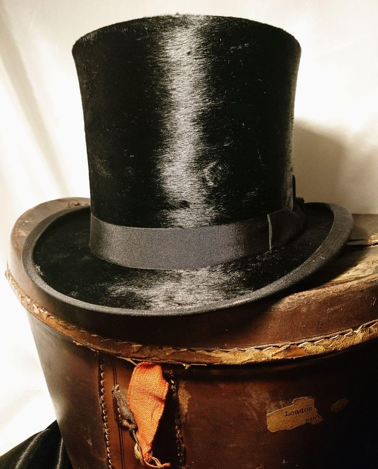 Victorian silk top hat with a fitted leather hat box, J Wippell and Co