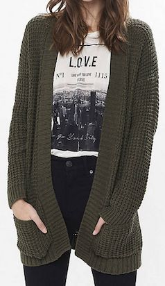 Keep warm by rocking an army green cardigan over a graphic tee!