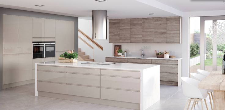 Wood and white is such a striking combination in a kitchen. This sleek, handleless design by Masterclass Kitchens coms in a range of white, neutral and grey gloss finishes, as well as five woodgrain finishes for a warmer feel.