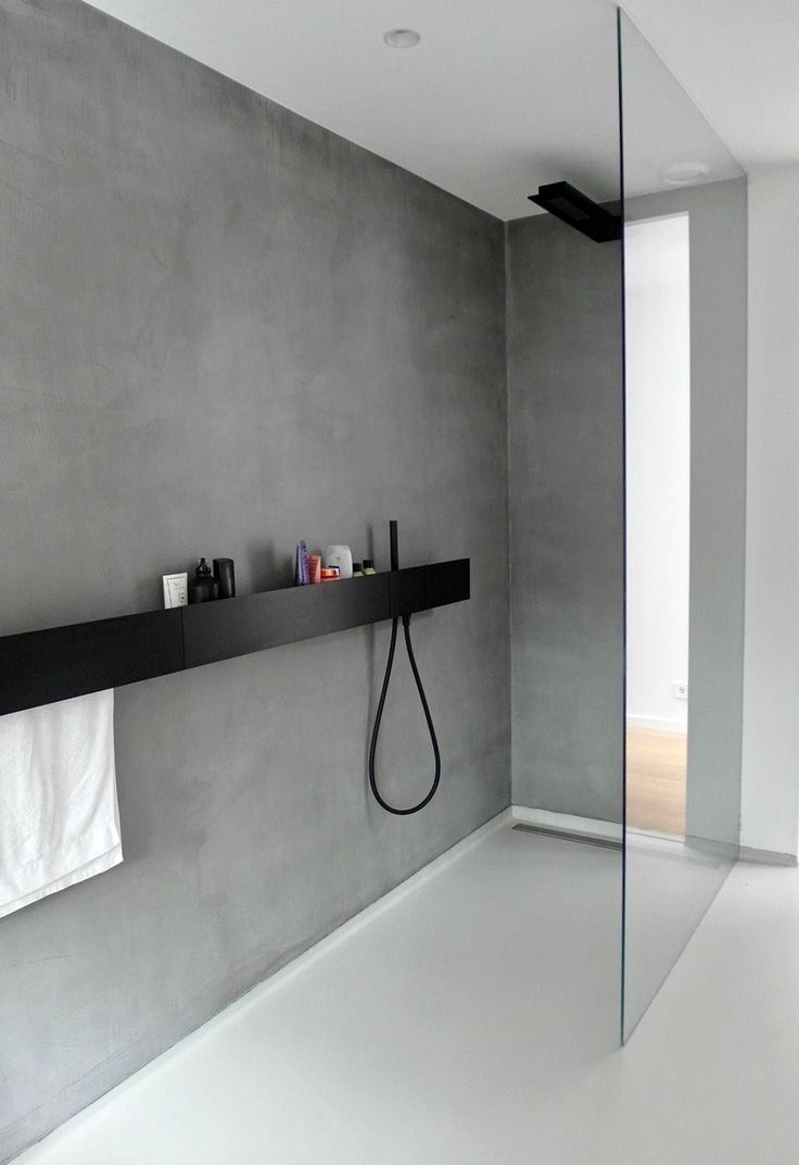 Minimalism. Nice but would change the glass wall with a concrete one to match—easy to clean.