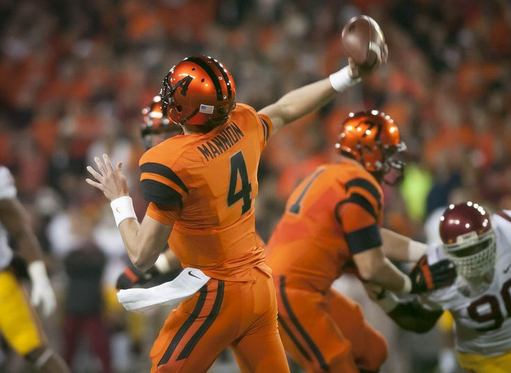 Sean Mannion throwing a pass against USC in 2013 while wearing the team's orange uniform. #gobeavs #oregonstate #beavers #uniform