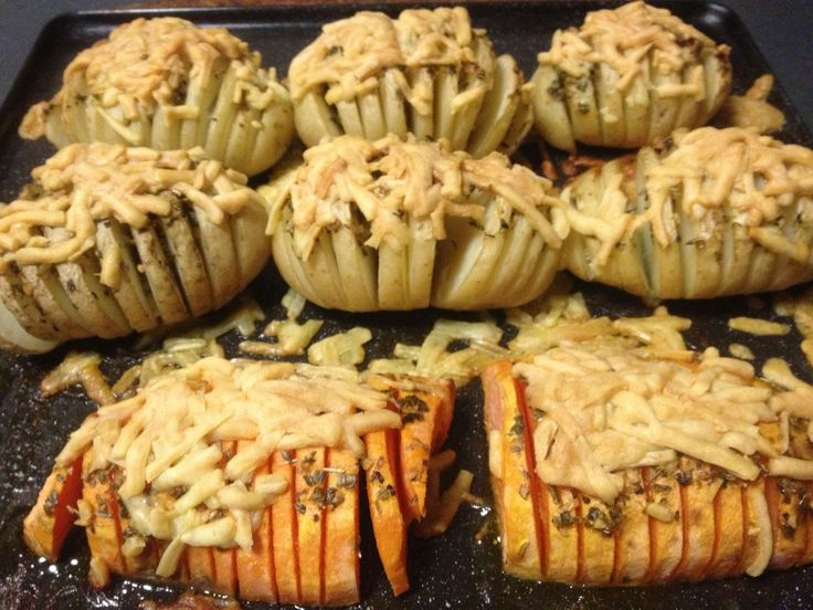 Jacket potato and sweet potato filled with YIAH herb and Garlic dip mix and butter topped with fresh parmesan cheese and baked in the oven.