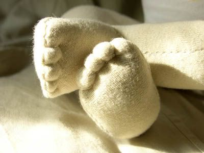 This seems like such a great handsewn doll to make and the website includes a pattern! The finished doll is newborn size and jointed - love the toes too! Must try to make one.
