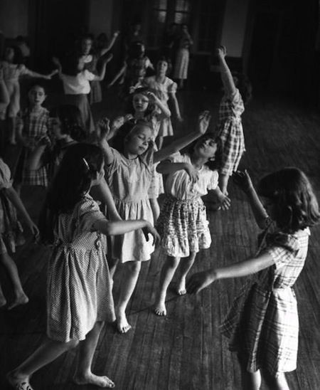 Young girls at Matthew F. Maury School improvising variations on their teacher's dance moves, Richmond, Virginia, USA, May 1950 by Nina Leen