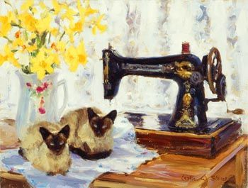 Siamese cats on a sewing table