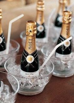 Mini champagne bottles on ice.   Repin by Inweddingdress.com  #weddings