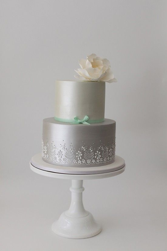 Beautiful hand piping on this silver cake.