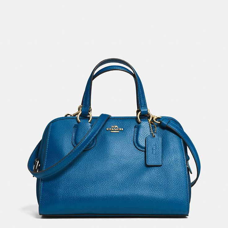 Updated in lightweight leather with a subtle pebbled texture, this softly structured satchel comes in a rich array of colors. The charmingly sized silhouette is finished with pretty ring hardware and bombé strap anchors inspired by archival Coach designs.