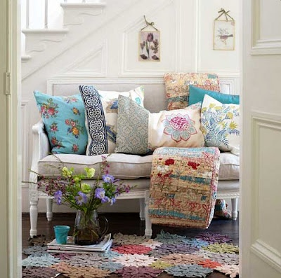 Love this to brighten a white entry hall... the pillows are so colorful and cheerful.