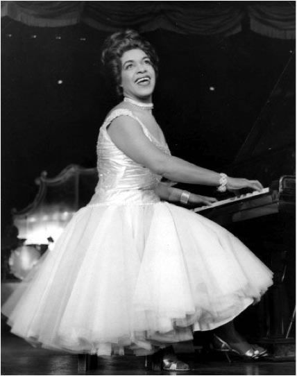Winifred Atwell (1914-1983) A Trinidad-born British pianist with a string of major ragtime and boogie woogie hits. She is STILL the only female instrumentalist to have a number one hit in the UK Singles Chart!