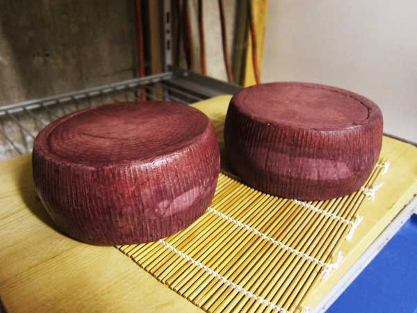 Ben wants a goat someday and claims he'll milk it (yeah, right), so I figured I'd start looking on how to make Goat Cheese!  This one has the finished product soaked in wine, which I wouldn't always do.