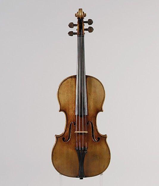 """1711 Italian (Cremona) Violin at the Metropolitan Museum of Art, New York - From the curators' comments: """"Stradivari experimented with the shape and arching of the violin. By 1700 he abandoned this pattern and reverted to the broader shape that was typical of his earlier violins....Stradivari employed flatter arching than his predecessors, and this contributed to the production of a more powerful tone."""""""
