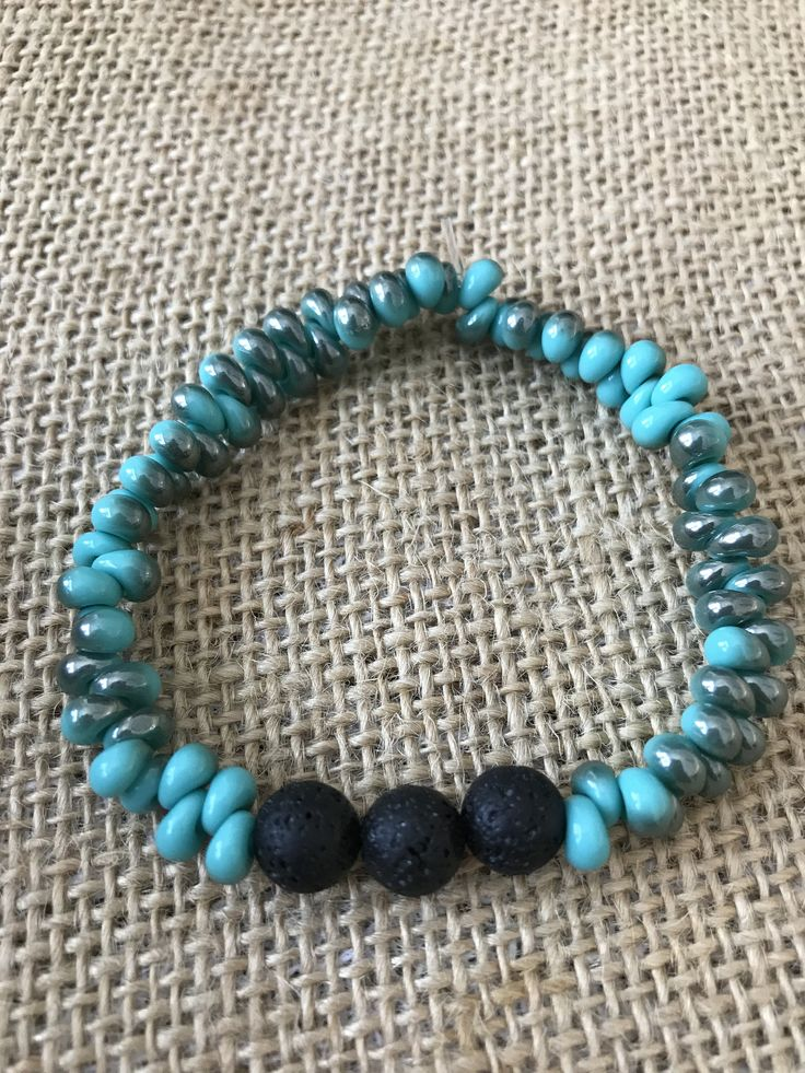 Aromatherapy lava bead diffuser bracelet for essential oils - turquoise/silver teardrop beads and black lava stones by MickandNick on Etsy