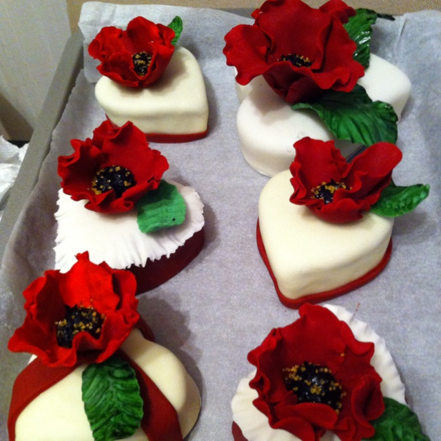 Heart shape mini cakes with abstract fondant flowers ...