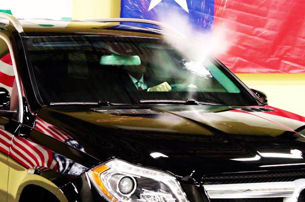 Texas Armoring Chief sits in a Mercedes GL behind reinforced glass while an employee shoots an AK-47 at the glass!