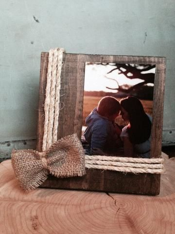 Hand made rustic wooden frame with twine and burlap accents. Frame is approximately 7 inches wide and 8 inches tall. Frame is made to fit your favorite 4x6 picture.