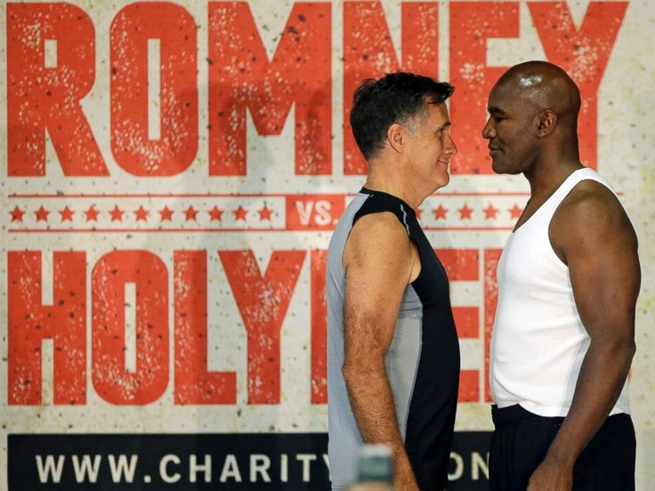PHOTO: Mitt Romney, left, and Evander Holyfield, right, face each other during an official weigh-in on May 14, 2015, in Holladay, Utah.