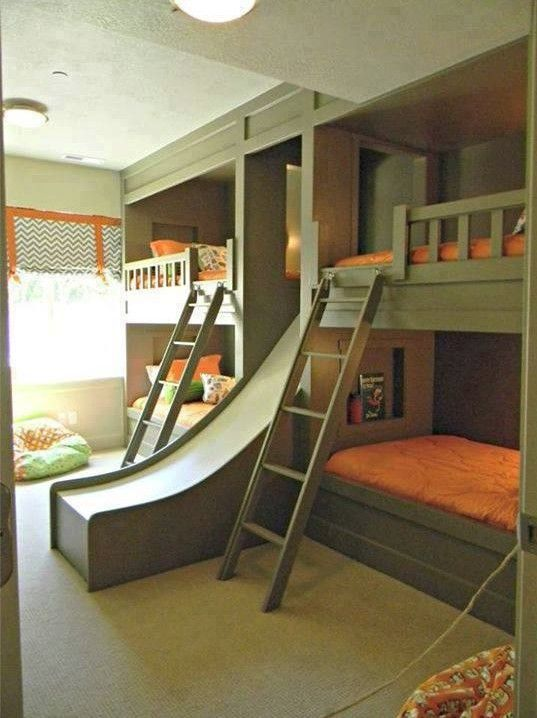 Bunk beds with a slide .. Great idea! although the younger kids might want top