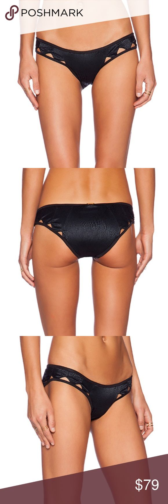 NWT Beach Bunny Jagged Edge Bikini Bottoms ABOUT THE BRAND 88% polyamide , 12% spandex Hand wash cold Monochromatic animal print Cut-out trim Beach Bunny Swim
