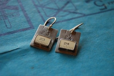 tape measure earrings. yes. please.