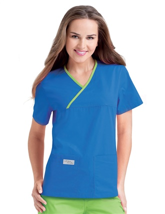 Double Pocket Crossover Top (9534) An updated Urbane favorite, this longer version of style 9501 features two deep pockets to keep your hands free and a relaxed fit for ease of movement. Available with contrast piping and in solid colors. +Select colors in while supplies last. Medium length 27½. XS–3XL.   Available in a variety of colors at Scrubs & More, The Uniform Store.
