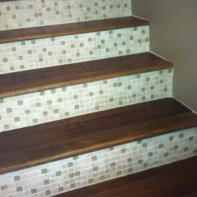 Tile and wood staircase. Love it!